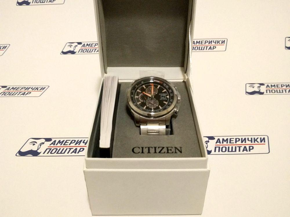 Citizen ručni sat u kutiji sa Američki poštar pozadinom